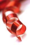 Een krullend rood lint Stock Foto's