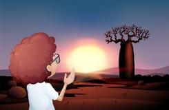 Een krullende jongen die op de zonsondergang in de woestijn letten royalty-vrije illustratie