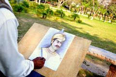 Een kunstenaar die een portret van een Mughal-Koning trekt Royalty-vrije Stock Foto