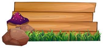 Een leeg houten uithangbord bij de rug van een paddestoel, rotsen en g Stock Fotografie