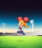 Een leuke cheerleader die bij het gebied presteren Royalty-vrije Stock Afbeelding