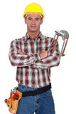 Loodgieter met zijn gekruiste wapens. Stock Foto