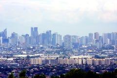 Een luchtmening van commerciële en woningbouw en ondernemingen in de steden van Cainta, Taytay, Pasig, Makati en Taguig stock afbeelding