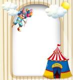 Een malplaatje met een clown en een circustent Stock Foto