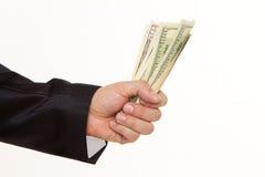 Een man hand die een handvol dollars houden Stock Afbeeldingen