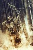Een mannelijke boogjager die gasmasker dragen Royalty-vrije Stock Afbeeldingen