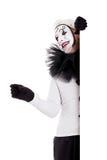 Een mannelijke clown kijkt over een grens Royalty-vrije Stock Foto