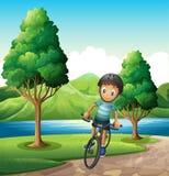Een mannelijke fietser die dichtbij de rivier biking vector illustratie