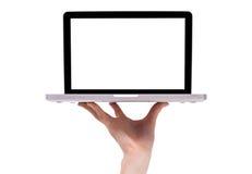 Een mannelijke hand die laptop houdt Stock Foto's