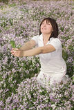 Een meisje in bloem Stock Fotografie