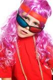 Een meisje in buitensporige kleren en 3d glazen Stock Fotografie
