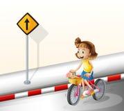 Een meisje die bij de weg biking royalty-vrije illustratie