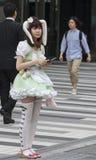 Een meisje die cosplay stewardessbar in Tokyo adverteren Royalty-vrije Stock Foto's