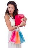 Een meisje doet winkelen geïsoleerd op wit Royalty-vrije Stock Afbeeldingen