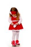 Een meisje in een gebreide kleding Stock Afbeelding