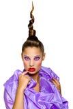 Een meisje in een lilac kleding Stock Foto