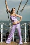 Een meisje in een roze kostuum Royalty-vrije Stock Foto's