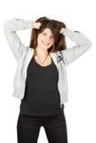 Een meisje in een sportkleding houdt op het hoofd Royalty-vrije Stock Afbeelding