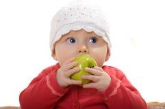 Een meisje met een appel. Stock Foto's
