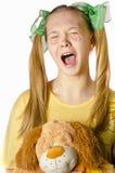 Een meisje met een stuk speelgoed Stock Foto's