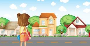 Een meisje met een zak over de buurt Royalty-vrije Stock Afbeelding
