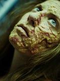 Een meisje met gebrande huidmake-up stock foto