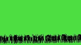 Een menigte van dansende mensen, allen in silhouet, op a greenscreen stock footage
