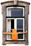 Een mens bij het venster Royalty-vrije Stock Afbeeldingen