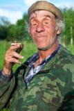 Een mens in camouflage Stock Afbeelding