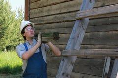 Een mens in de vorm van een bouwer Royalty-vrije Stock Afbeelding
