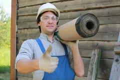 Een mens in de vorm van een bouwer Royalty-vrije Stock Foto's