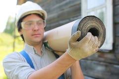 Een mens in de vorm van een bouwer Stock Fotografie