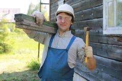 Een mens in de vorm van een bouwer Royalty-vrije Stock Foto