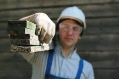 Een mens in de vorm van een bouwer Stock Foto's