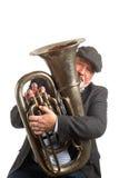 Een mens die een Tuba spelen stock afbeelding