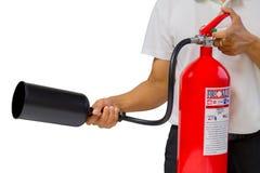 Een mens die tonen hoe te brandblusapparaat te gebruiken dat over wit wordt geïsoleerd Royalty-vrije Stock Afbeeldingen