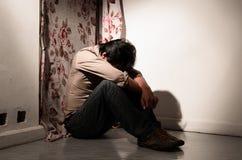 Een mens in eenzame emotie Stock Afbeelding