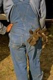 Een mens in het werkkleren Stock Fotografie