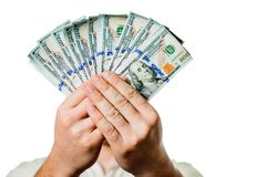 Een mens houdt geld in de handen van een ventilator, dollarsclose-up op een witte achtergrond royalty-vrije stock foto