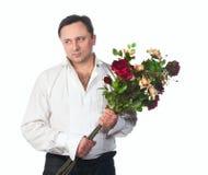 Een mens met een boeket van rozen Stock Afbeeldingen