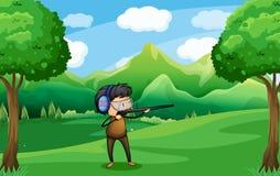 Een mens met een kanon bij het bos stock illustratie