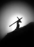 Een mens met een kruis op zijn schouder Stock Foto's
