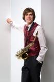 Een mens met een saxofoon Stock Foto