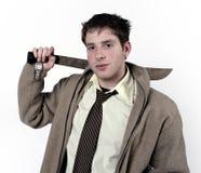 Een mens met een zwaard. Stock Foto