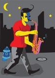 Een mens met saxofoon Stock Afbeelding