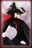 Een mens in Venetiaans masker stock foto's