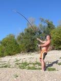 Een mens visserij Royalty-vrije Stock Afbeeldingen
