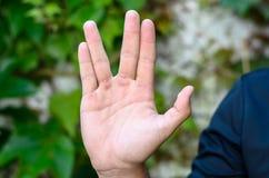 Een mensenhand die de Vulcan-begroeting doen stock foto's