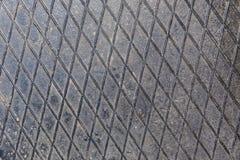Een metaalplaat op de vloer Stock Afbeeldingen