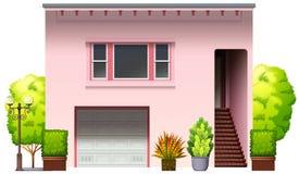 Een modern roze huis Stock Afbeeldingen